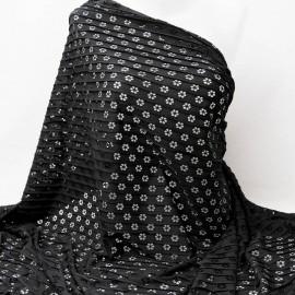 Au mètre Jersey polyester noir ajouré fleurettes en 145cm n°910