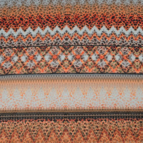 Au mètre Tissu fin jersey viscose  orange ethnique en 150cm 979
