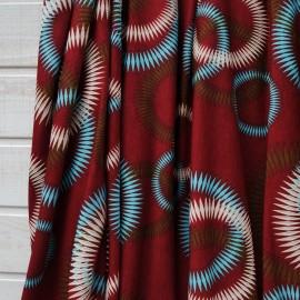 Coupon Jersey Viscose fond bordeaux rouille à cercles turquoise et beiges 1m50 en 150cm n°10292