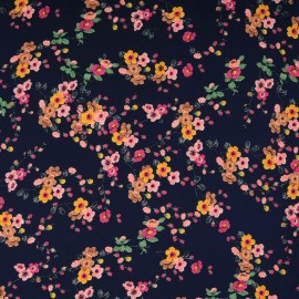 Au mètre microfibre polyester fond bleu marine à fleur en marron, rose et orange en 150cm n°10333