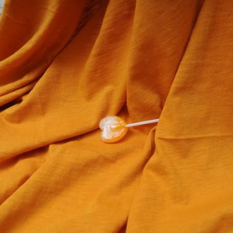 Au mètre, jersey coton flammé safran en 180cm n°10337