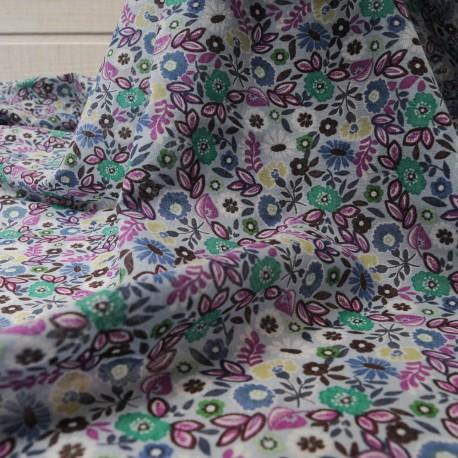 Au mètre Voile Coton Haute Couture fond bleu avec une base en 140cm n°10381