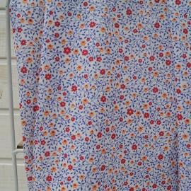 Au mètre jersey coton fond blanc, fleurette corail et rouge, feuillage bleu en 155cm n°10409