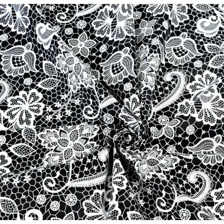 Coton OEKO TEX façon dentelle blanche sur fond noir en 160cm