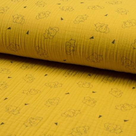 Au mètre Coton Triple Gaze en 130cm éléphant fond moutarde n° 10684