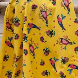 Tissu sweat French Terry jaune imprimé oiseaux rose en 145cm n°10719