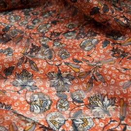 Au mètre voile polyester rayure lurex doré fond orange en 145cm