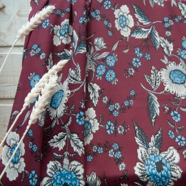 Au mètre crêpe polyester bordeaux motif floral beige et bleu n°10794