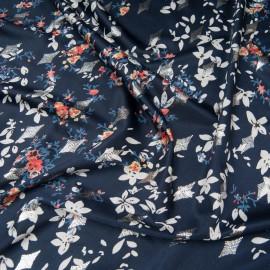 Au mètre maille polyester et Lycra bleu marine, motif losange argenté sur petit bouquet fleuri beige et orange n°10201